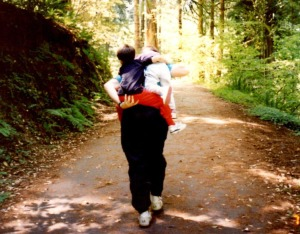 My dad carrying my little sister and me in the Redwood National Forest