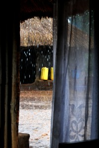 A view of a heavy rain from inside the safety of David's hut.