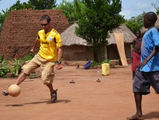 Playing soccer in Layibi Village at my friend David's.