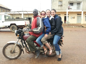 Becca, Sarah, and Dana jammed onto a boda boda.