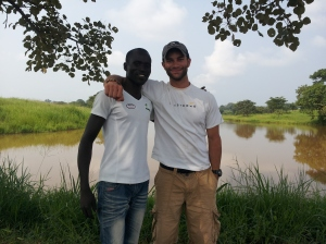 Me standing with Fredy at the pond he took us to.
