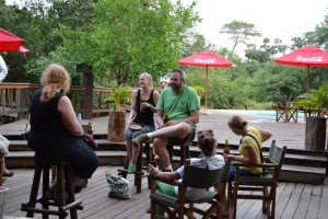 Some of the gang hanging out on the deck near the pool at the place where we were staying before the Rhino Trek.